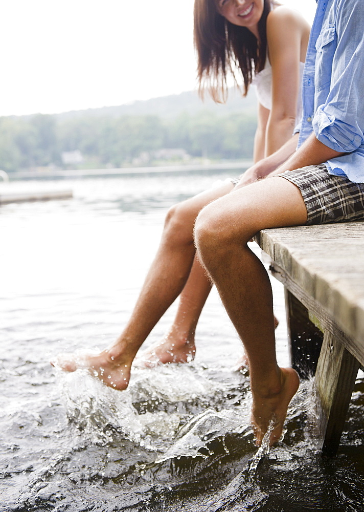 Roaring Brook Lake, Close up of couple sitting on pier by lake