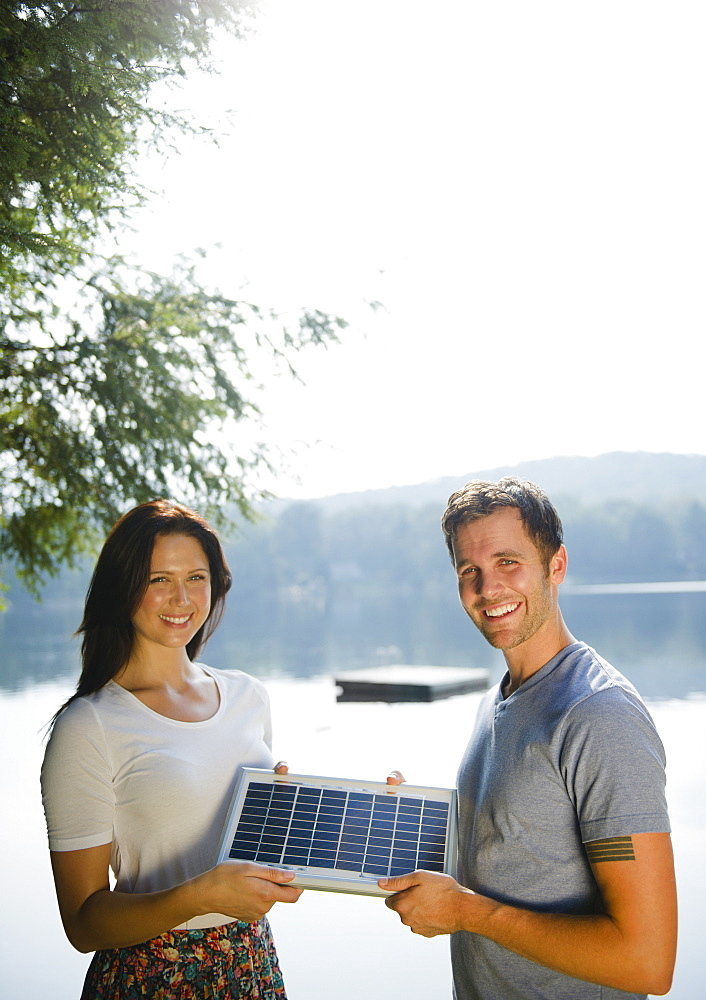 Roaring Brook Lake, Couple holding solar panel