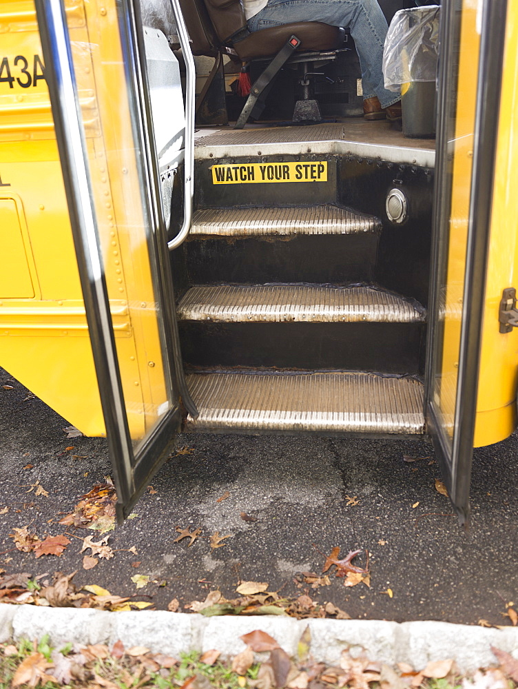 Close up of open door of school bus