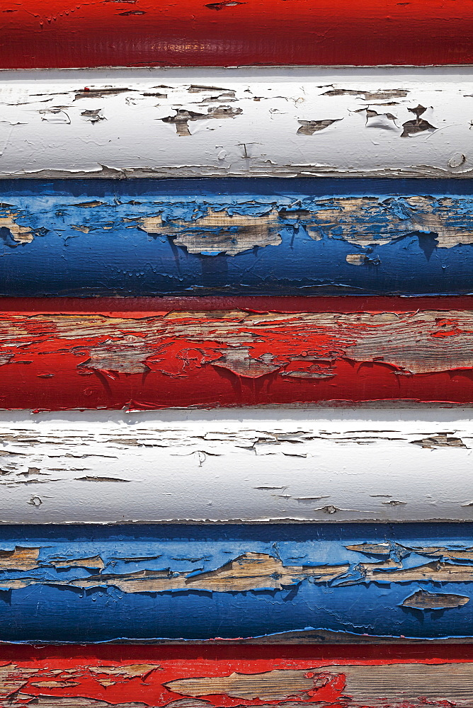 Red, white and blue peeling paint