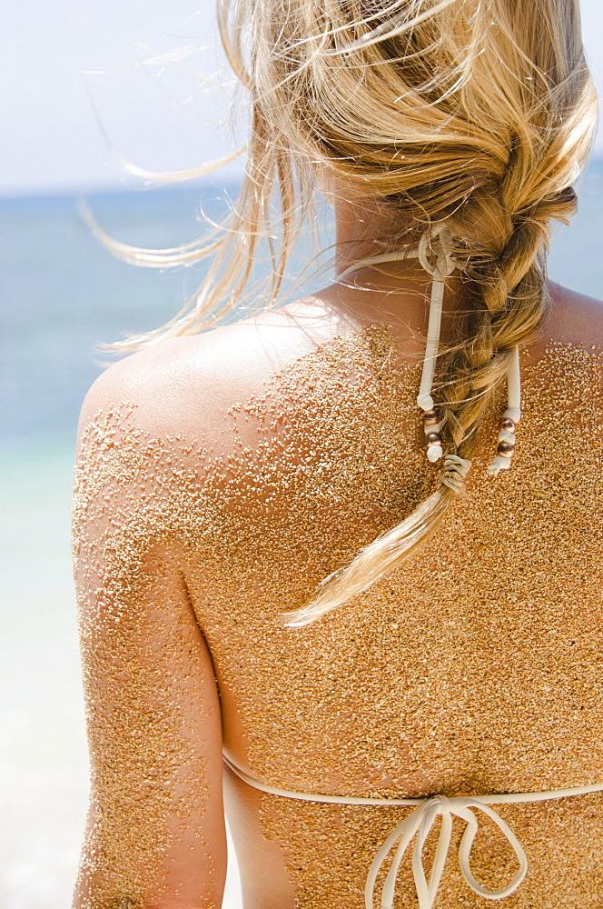 Woman's back with sticking sand, USA, Hawaii, Kauai, Princeville