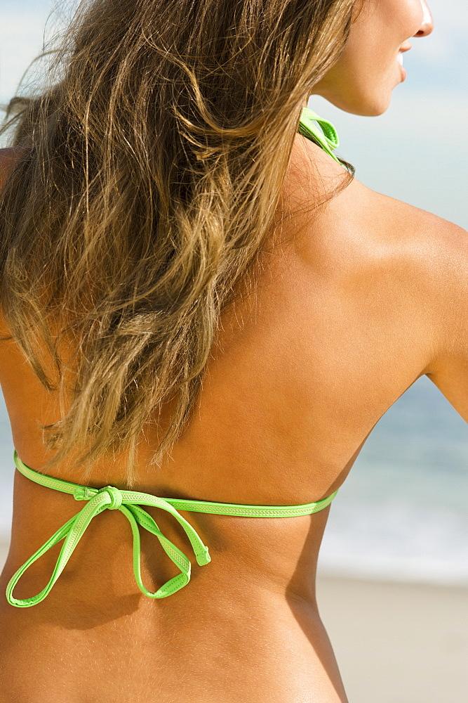 Woman sunbathing at beach