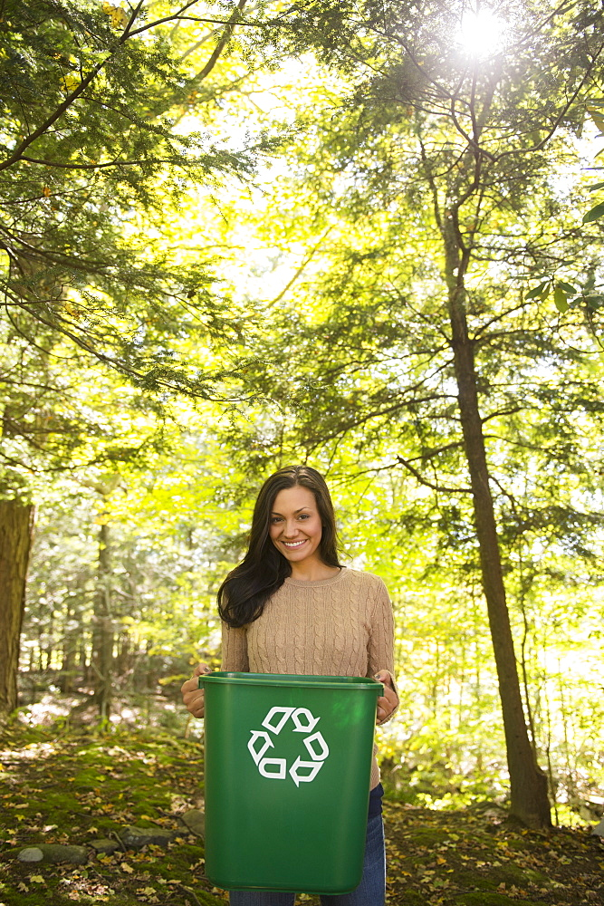 Woman holding recycling bin, Newtown, Connecticut