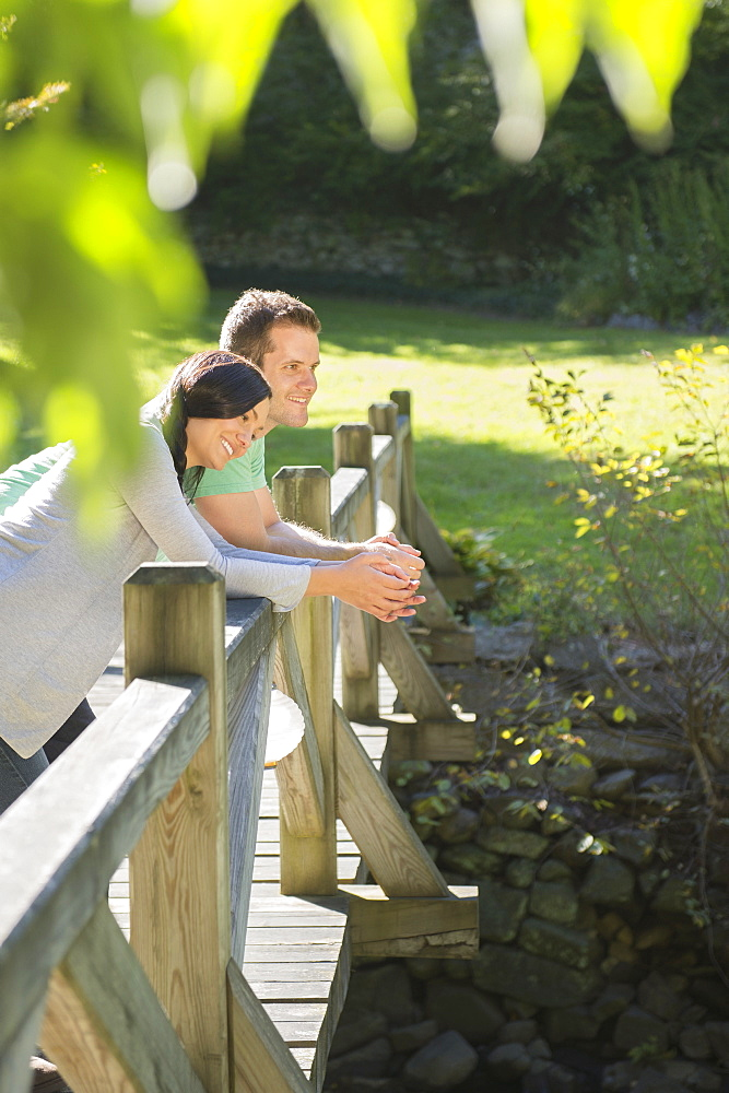 Couple standing on wooden bridge, Newtown, Connecticut
