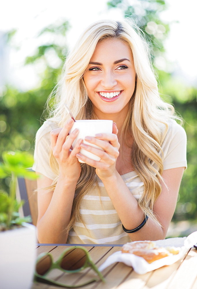 Portrait of teenage girl (16-17) drinking coffee