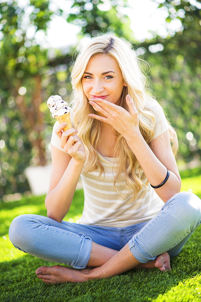 Portrait of teenage girl (16-17) eating ice cream