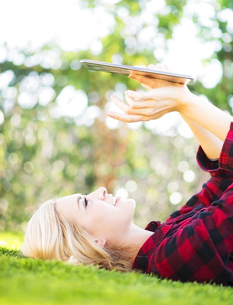 Teenage girl (16-17) using digital tablet