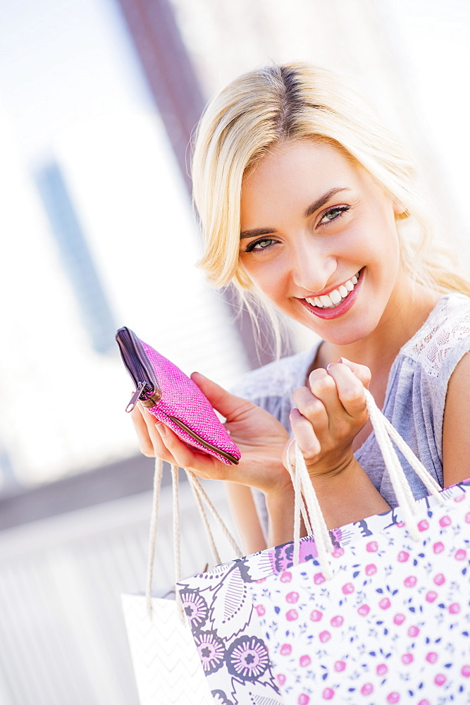 Portrait of teenage girl (16-17) holding shopping bags