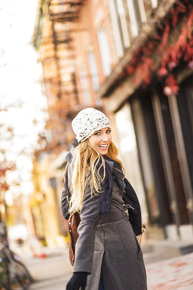 Portrait of woman on sidewalk, USA, New York City, Brooklyn, Williamsburg