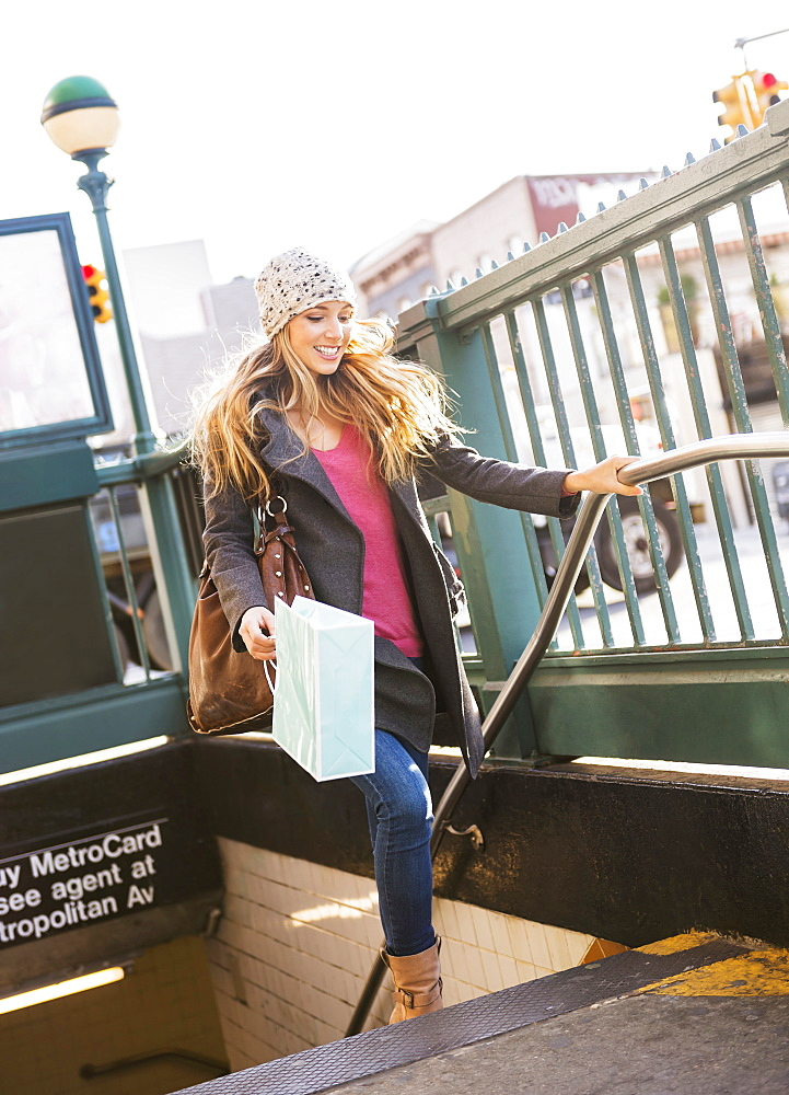 Portrait of blond woman leaving subway station, USA, New York City, Brooklyn, Williamsburg