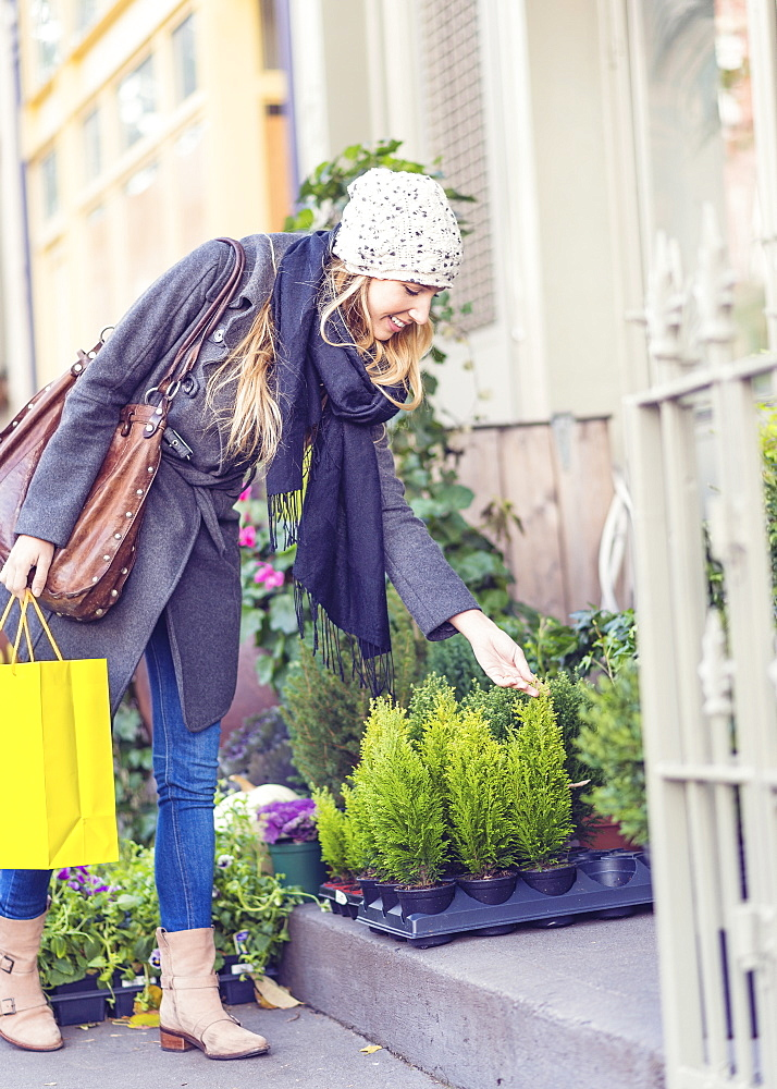 Portrait of blond woman buying plants, USA, New York City, Brooklyn, Williamsburg