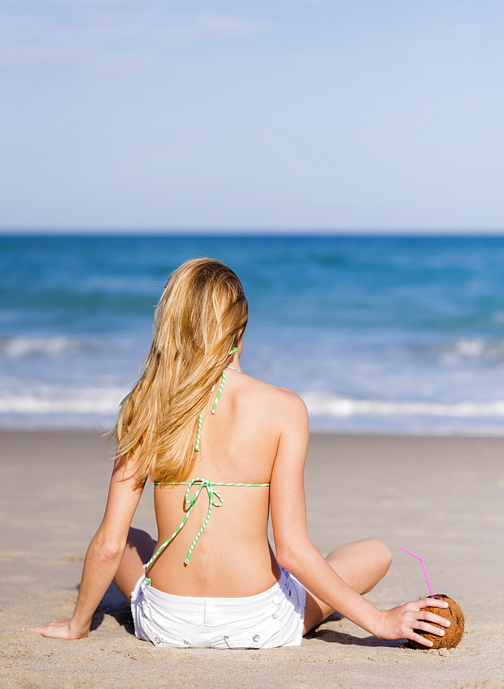 Young woman on beach, Jupiter, Florida, USA