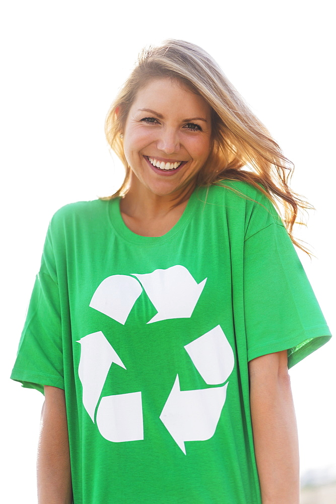 Front view of woman wearing green t-shirt