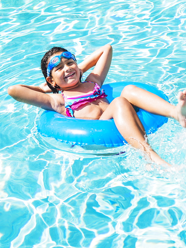 Portrait of girl ( 8-9) with inflatable ring