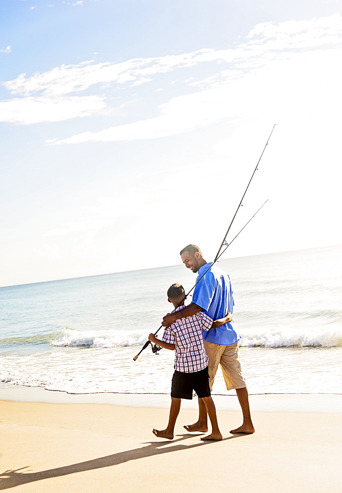 Father and son (10-11) fishing, Jupiter, Florida