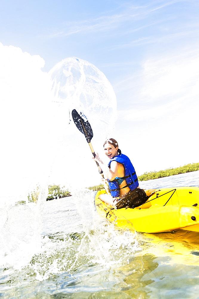Woman kayaking, Jupiter, Florida