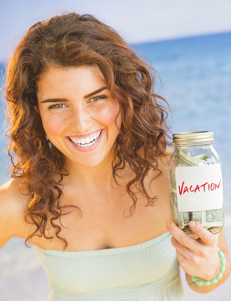 Portrait of smiling woman with vacation found