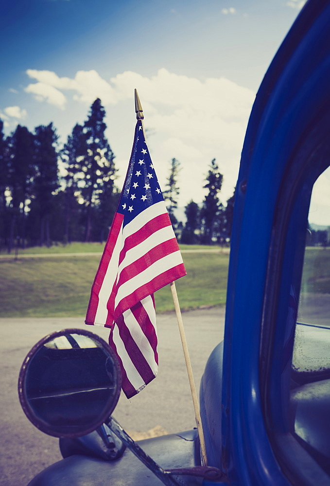 American flag attached to truck, Hill City, South Dakota