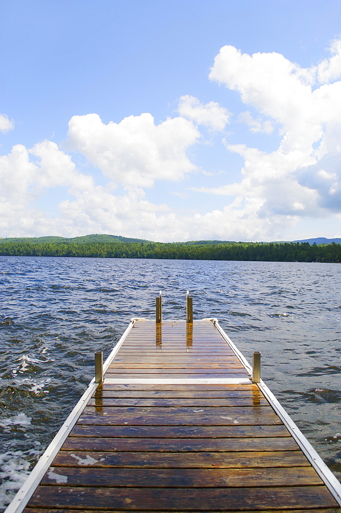 View of lake with wooden jetty, USA, Maine, Camden