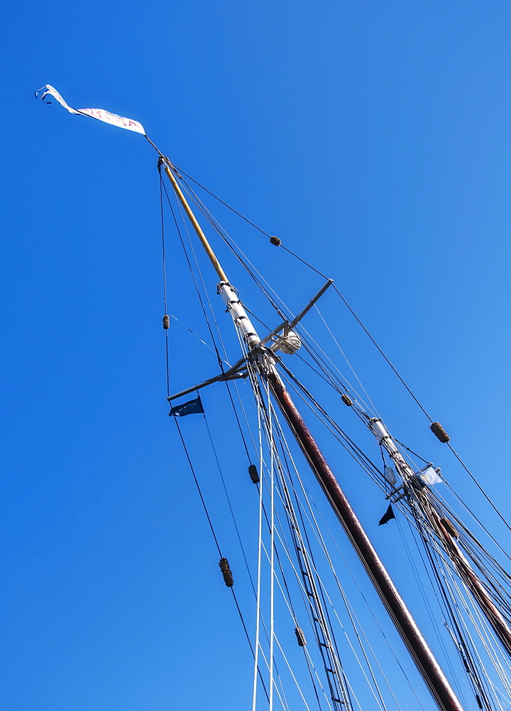 Low angle view of yacht mast against blue sky