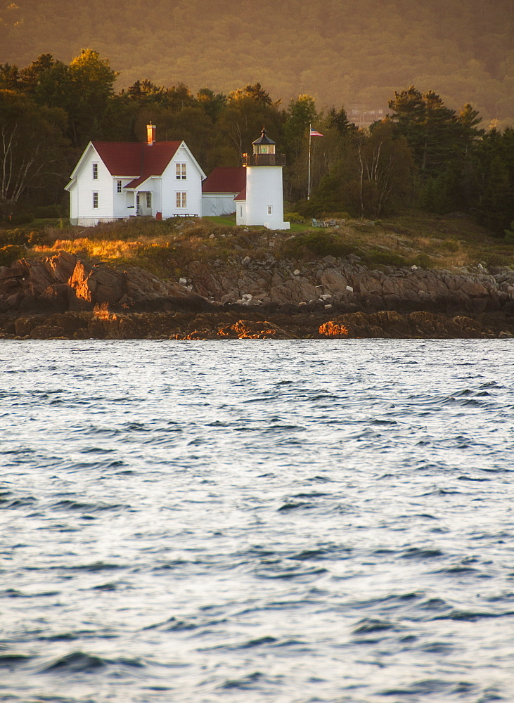 View of sea shore with small lighthouse, USA, Maine, Camden