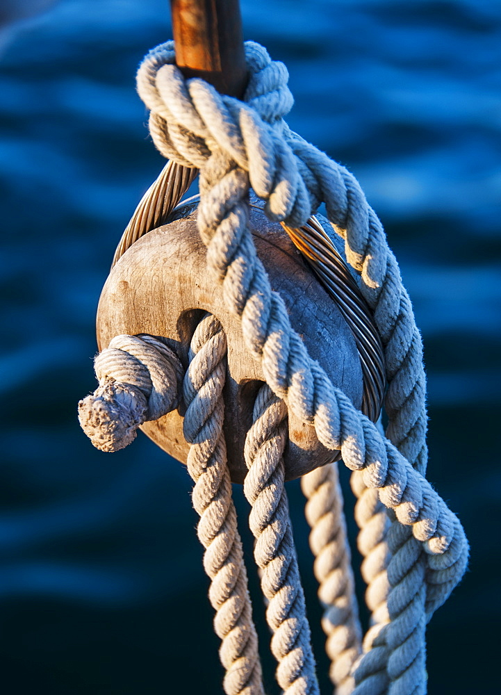 Close-up view of yacht ropes against rippled water