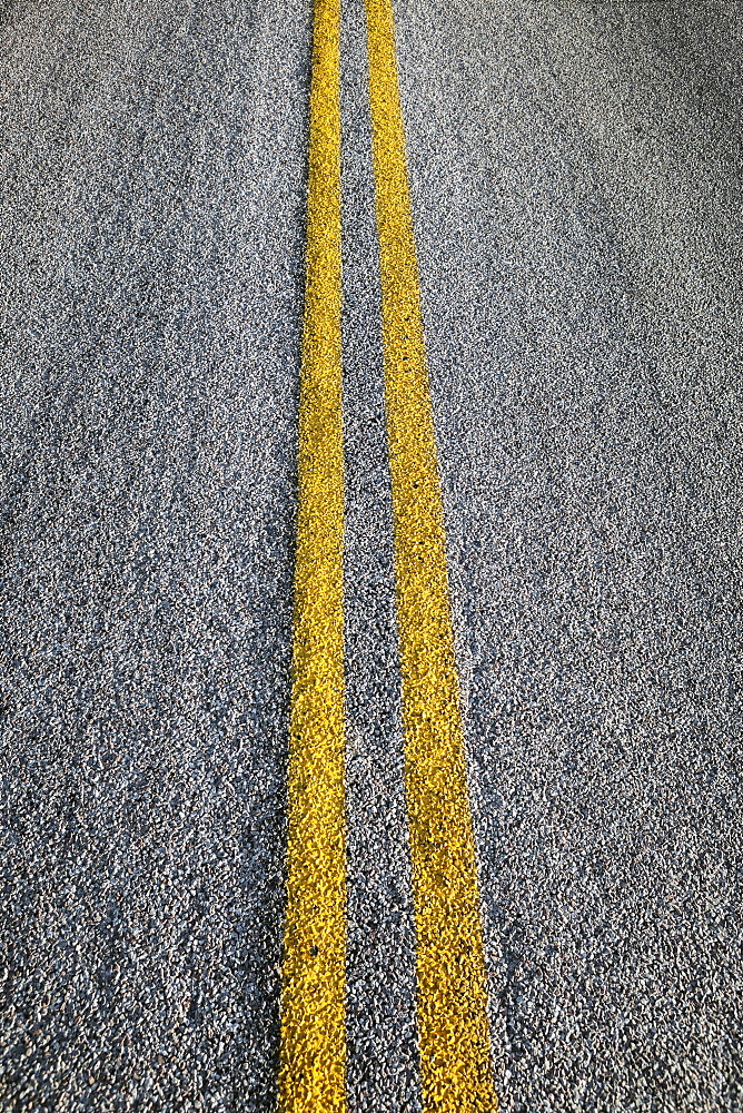 Close-up of double yellow line on road