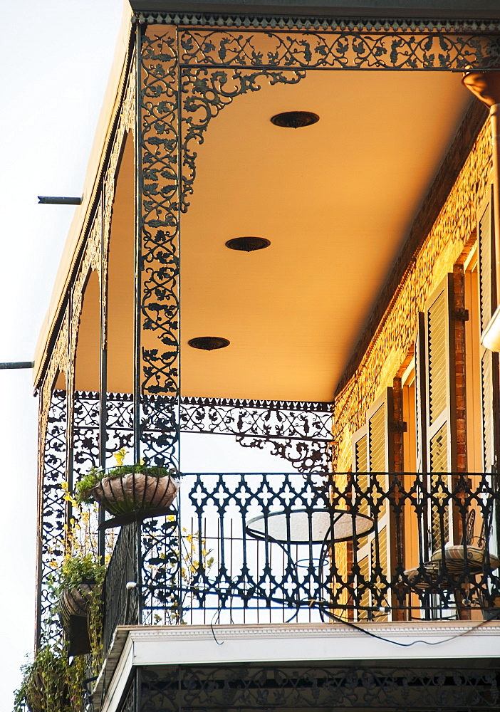 Ornate balcony with potted plants, USA, Louisiana, New Orleans