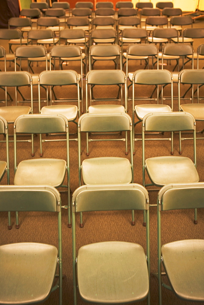 Empty folding chairs in rows