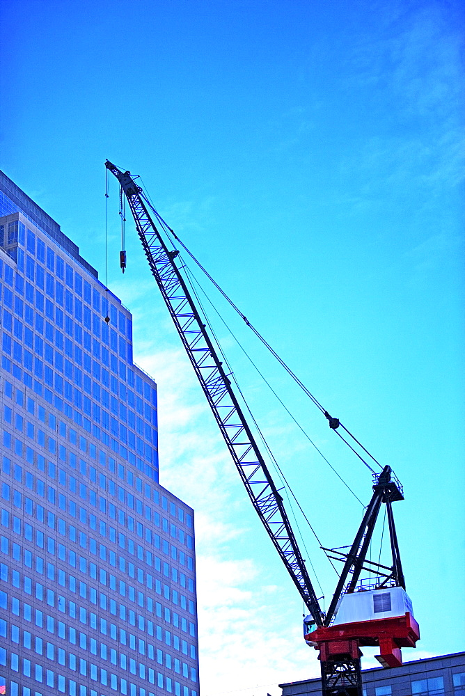 Crane and high-rise under blue sky