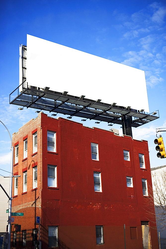 Blank billboard on urban building