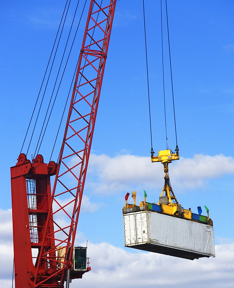 Crane lifting a shipping container