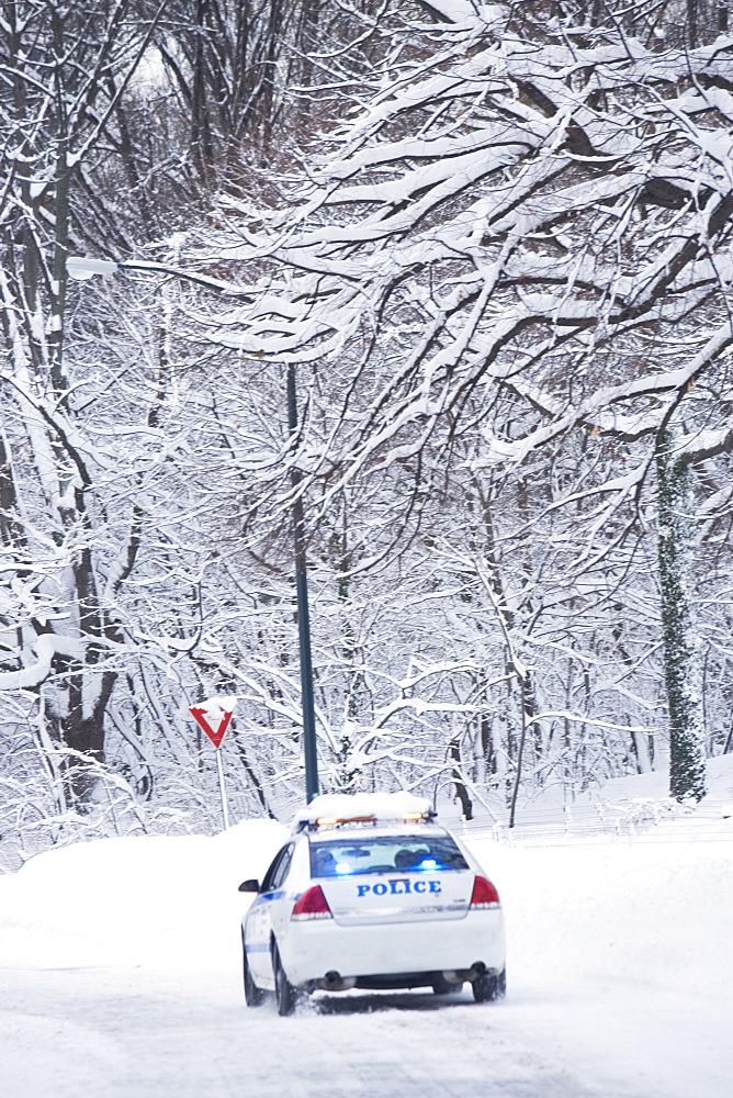 USA, New York City, police car on snowy road