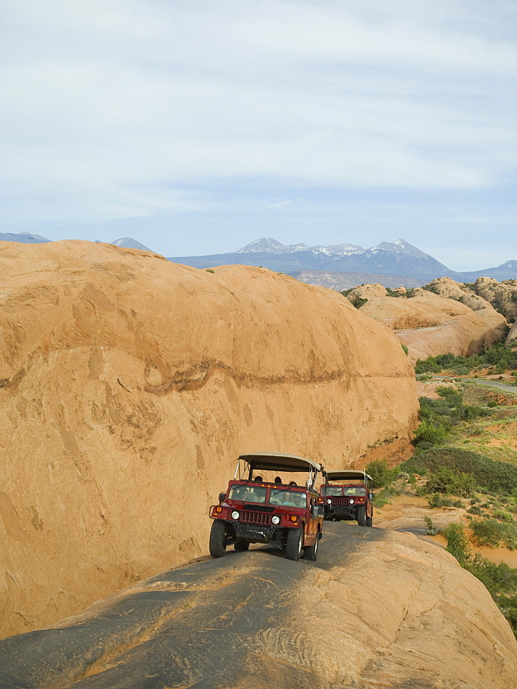 Off-road vehicles driving on rock formation