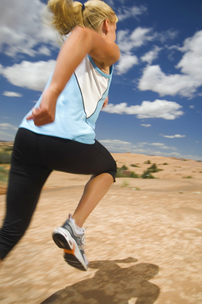 Woman jogging in desert