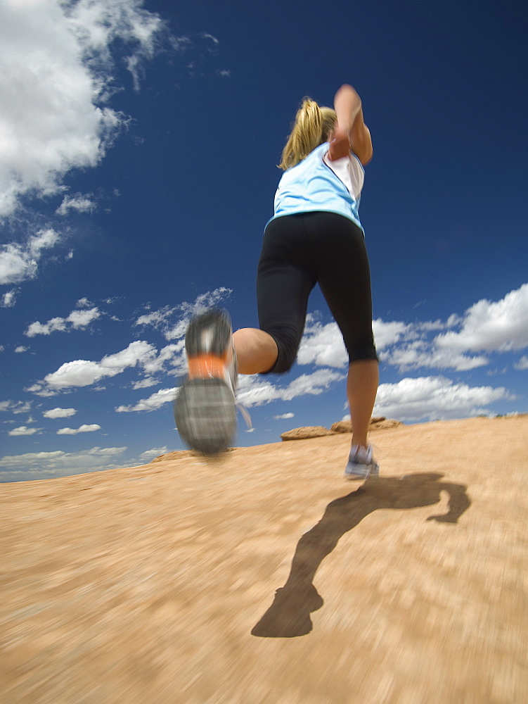 Low angle view of woman jogging