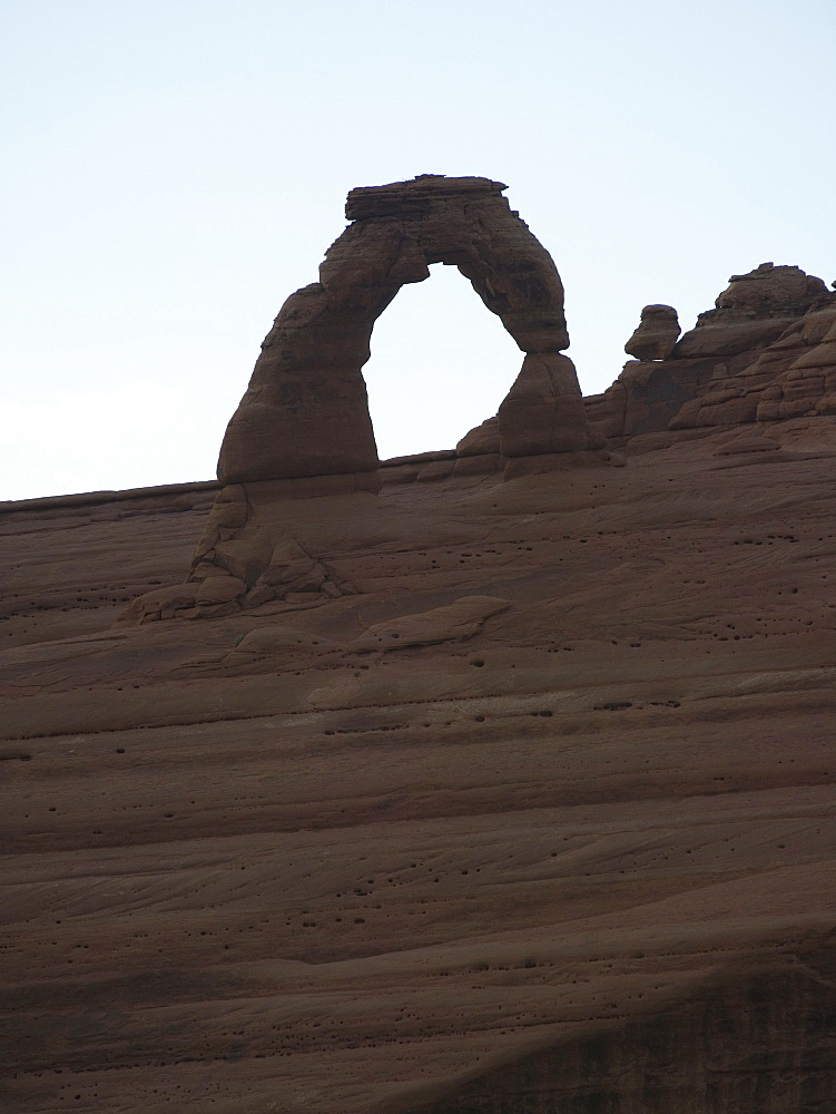View through rock formation to blue sky