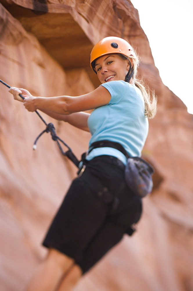 Close up of woman rock climbing