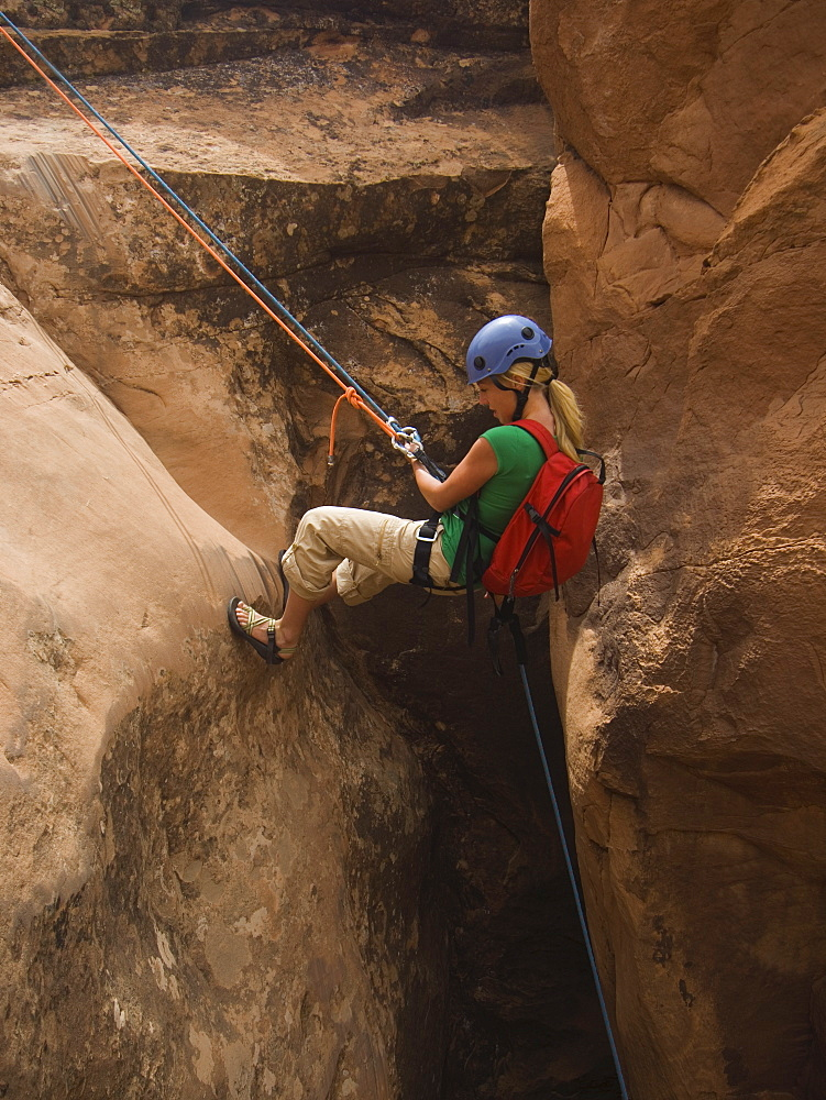 Woman canyon rappelling