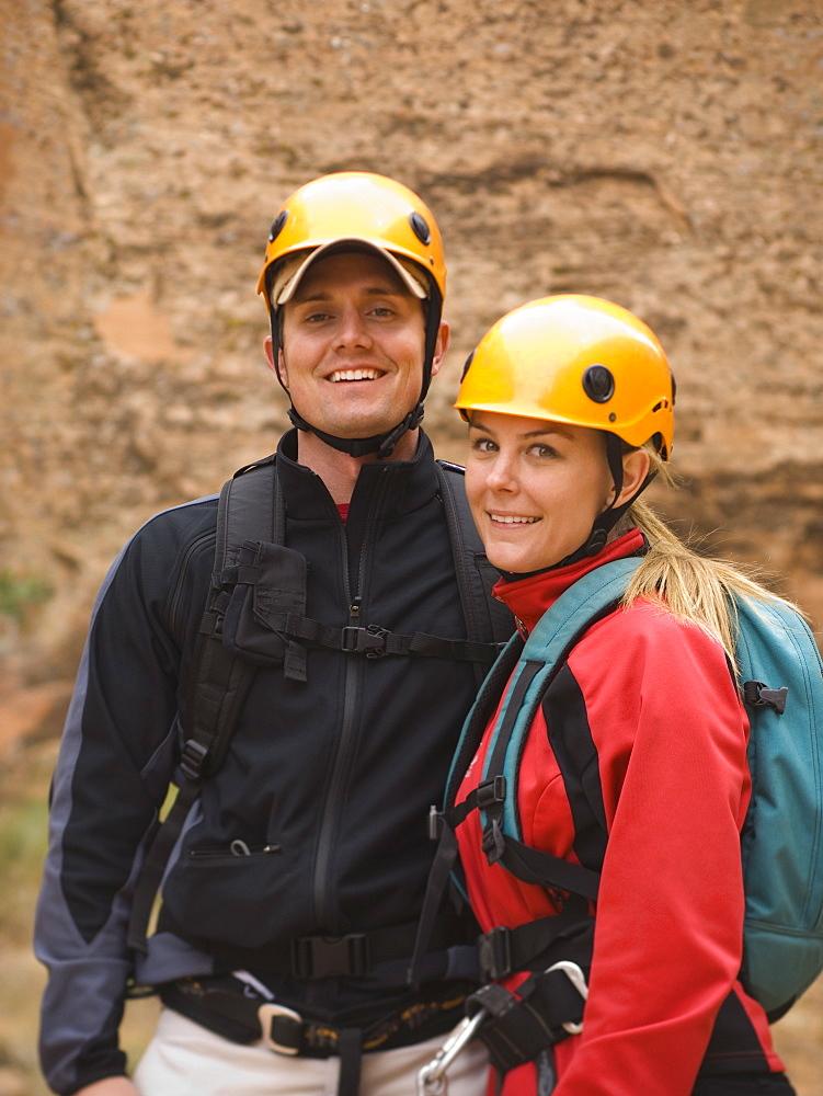 Couple wearing rappelling gear