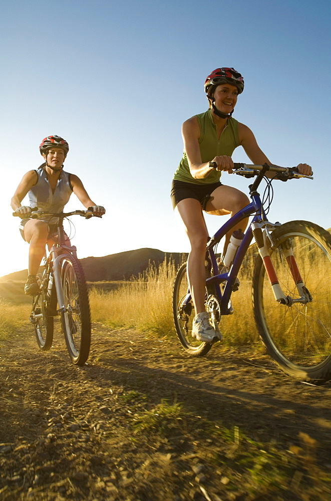 Two women riding mountain bikes, Salt Flats, Utah, United States
