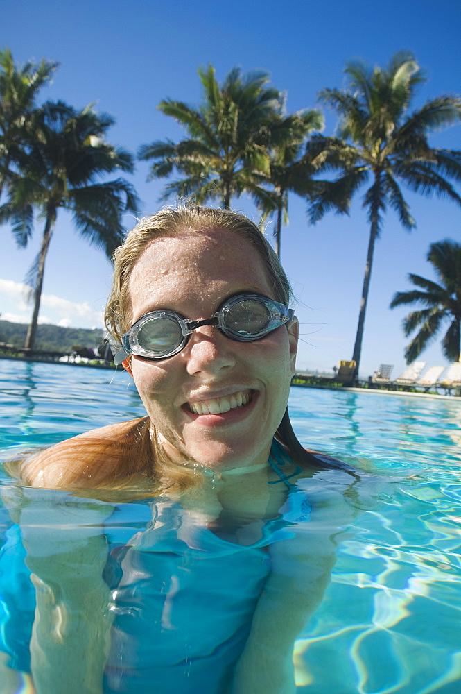 Woman wearing goggles in swimming pool