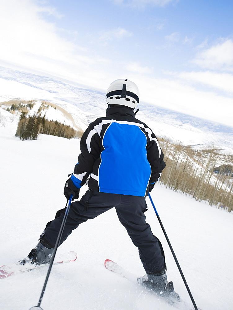 Child skiing downhill