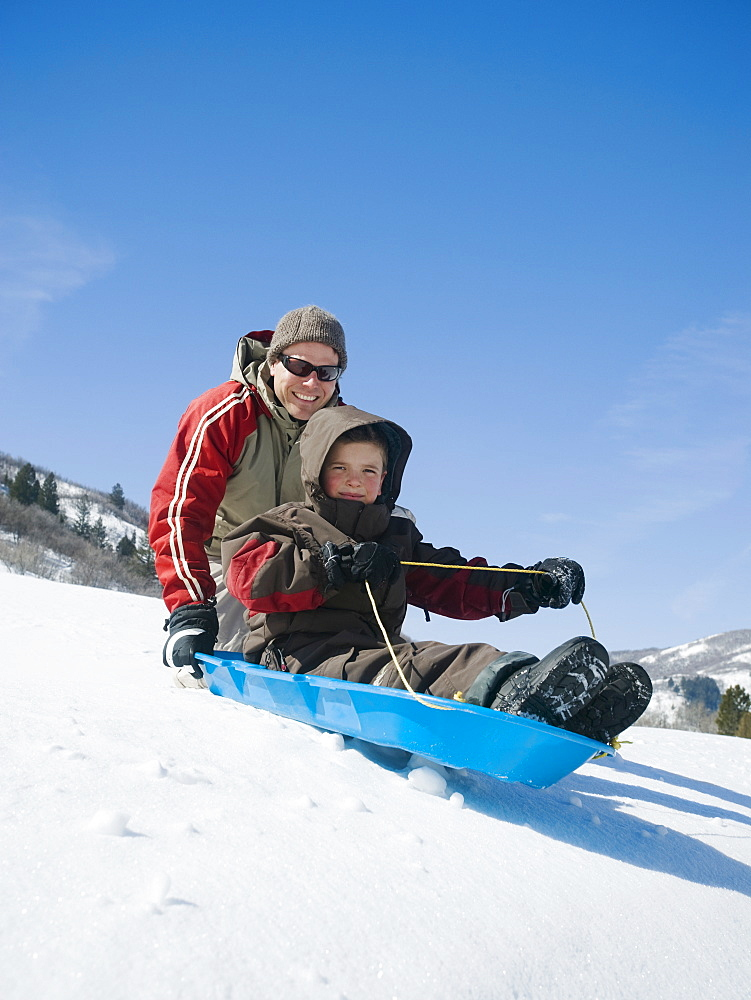 Father and son on sled