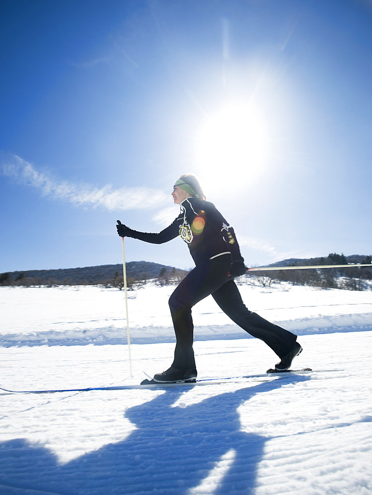 Woman cross country skiing