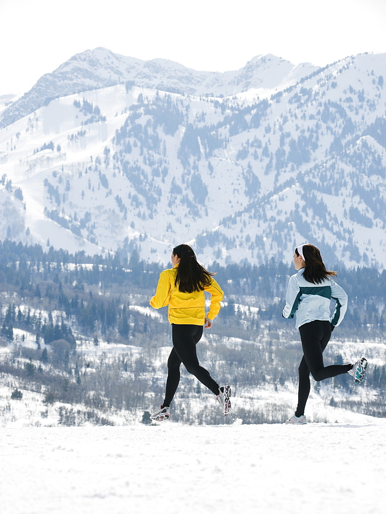 Women running in snow