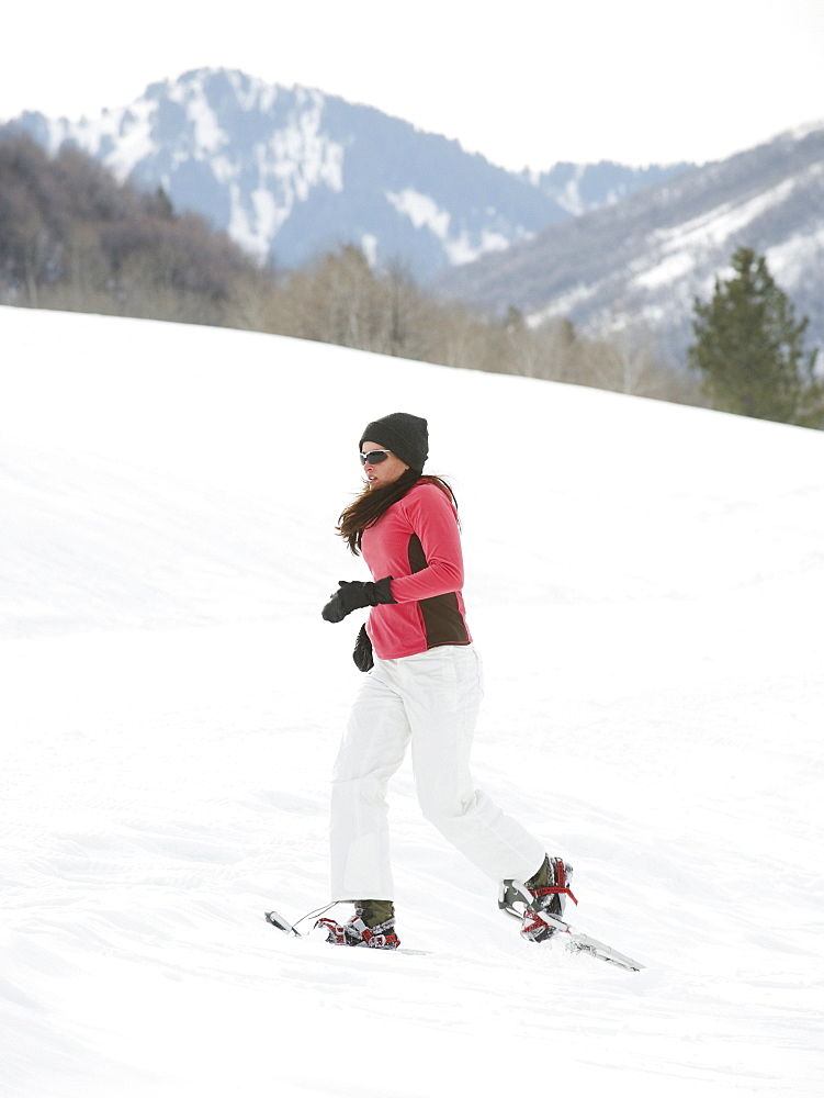 Woman snow shoeing