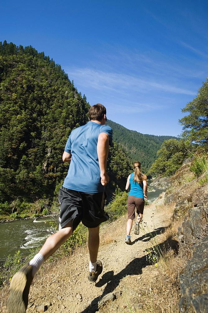 Runners on riverside trail