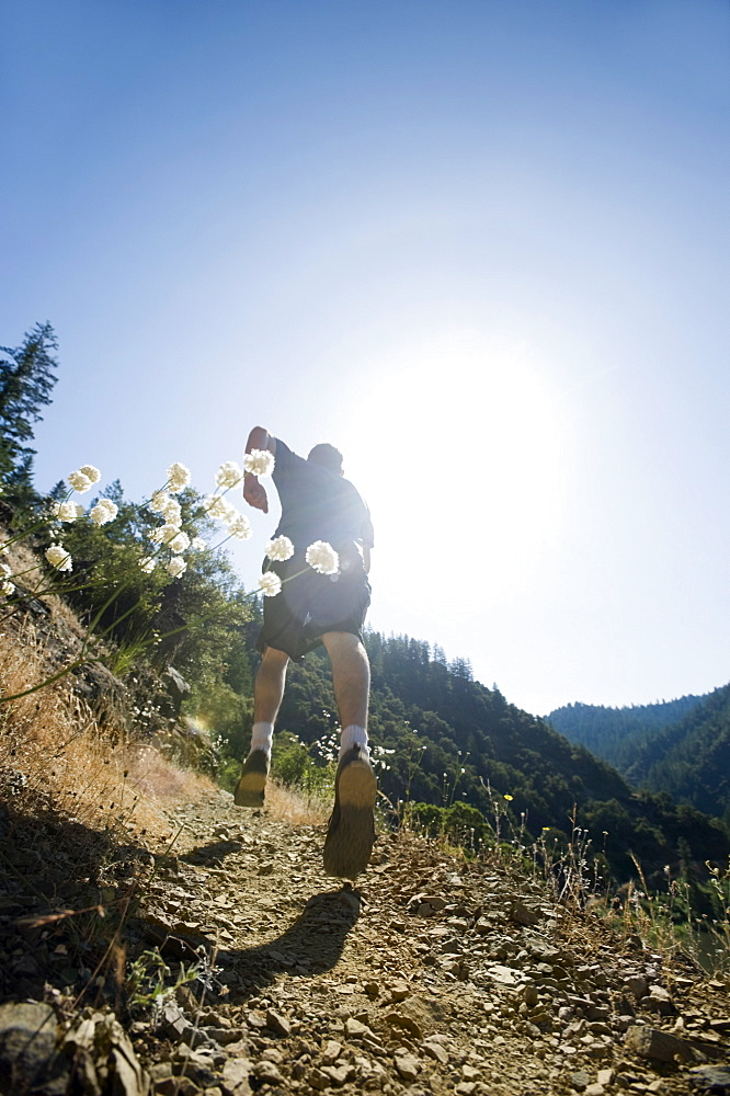 Man running on steep trail