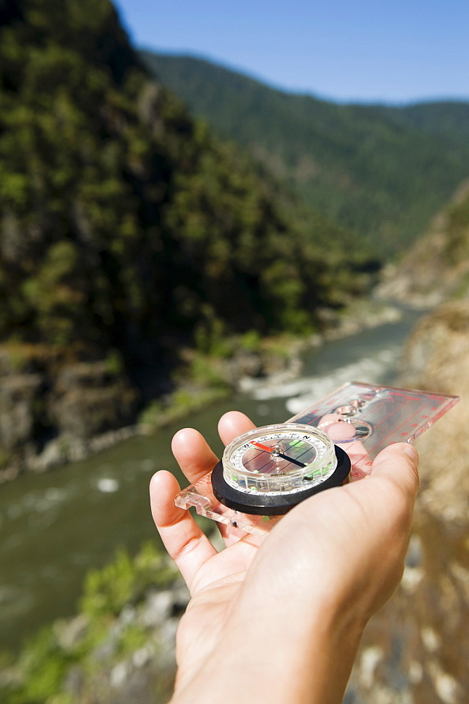 Hiker holding compass